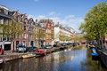 Boats on amsterdam canal in spring netherlands north holland province Stock Image