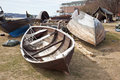 Boats ashore large launches lying on the shore for repairs Stock Images