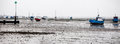 Boats beached at southend at low tide motor and yachts on the sands on the thames estuary Royalty Free Stock Images