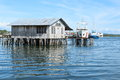 Boats behind a fishers house in Sorong Royalty Free Stock Photo
