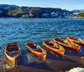Boats at bled lake slovenia beautiful landscape historic buildings Royalty Free Stock Photos
