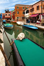 Boats in burano italy february beginnings of touristic season on the streets of the small village of with the first beautiful Royalty Free Stock Photos
