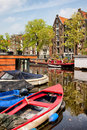 Boats on canal in amsterdam and historic apartment buildings along the brouwersgracht brewers netherlands north holland Stock Photos