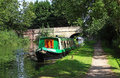 Boats in a canal lock narrowboats moored on the kennet avon west berkshire Royalty Free Stock Image