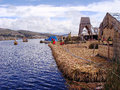 Boats are coming to floating island Uros on the lake Titicaca Stock Images