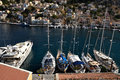 Boats at the dock the island of symi top view yachts in marina in bay dodecanese greece Royalty Free Stock Image
