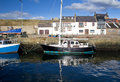 Boats docked in burghead harbour small village on the moray coast of scotland Stock Photos