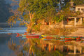 Boats at fewa lake colourful pokhara in the morning sun Royalty Free Stock Photos
