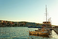 Boats and fishing trawler moored in the harbor of a small town Postira - Croatia, island Brac Royalty Free Stock Photo