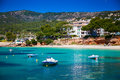Boats in front of the beach in portals nous small mallorca spain Royalty Free Stock Images