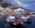Boats in harbour amalfi italy traditional fishing the with the town to the rear coast campania europe Royalty Free Stock Image