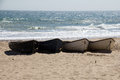 Boats high and dry dingy s sitting on bournemouth beach Stock Photography