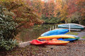 Boats julian price lake autumn blue ridge parkway north carolina landscape of where colorful are stacked at water s edge and the Stock Image