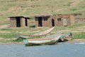 Boats at the kazinga channel sunny scenery including some and shacks waterside in uganda africa Stock Photos