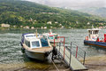 Boats on the lago maggiore different in italy Royalty Free Stock Photo