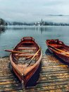 Boats at lake bled slovenia pier overlooking Royalty Free Stock Image
