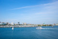 Boats in long beach harbor sail boat and large yacht cruise across s southern california Royalty Free Stock Photo
