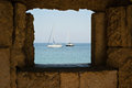 Boats on the med a stone wall framed image of two sail Royalty Free Stock Photography