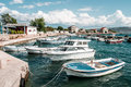 Boats moored in harbor row of Royalty Free Stock Photography