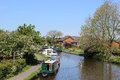 Boats moored on the lancaster canal at garstang view from a bridge kepple lane over in in lancashire to both sides of Royalty Free Stock Photo