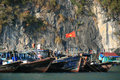 Boats are moored near a floating village in the halong bay vietnam on february Stock Images