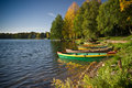 Boats near lake by in fall forest Royalty Free Stock Images