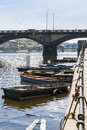 Boats near the shore on background of an old bridge Royalty Free Stock Images