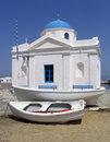 Boats next to seaside church, Mykonos, Greece Stock Images