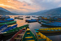 The boats in phewa tal fewa lake before sunset at pokhara nepal mar Royalty Free Stock Image