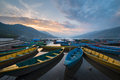 The boats in phewa tal fewa lake before sunset at pokhara nepal mar Stock Photo