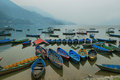 Boats in the pier of Fewa lake in Pokhara Royalty Free Stock Photo