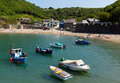 Boats polkerris harbour cornwall england near st austell and par on a beautiful summer day with blue sea and sky Royalty Free Stock Images