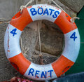 Boats for rent tourism image of a rustic sign on a lifebuoy Stock Photo