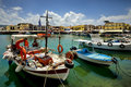 Boats and restaurants in the old venetian port of rethymno on crete island in greece Royalty Free Stock Image