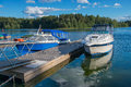 Boats resting at the pier rowboat and two standing by engine power Stock Photography