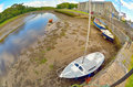 Boats on the river shore in ireland Stock Images