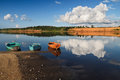 Boats on the river three and cloud reflacted in Stock Photo
