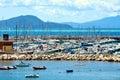 Boats, rocks, coast, Salivoli, in Livorno, Tuscany, Italy Royalty Free Stock Photo