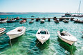 Boats row of moored in harbor Stock Photography
