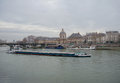 Boats on seine and institut de france paris march barges river view of Royalty Free Stock Images