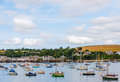 Boats and ships moored in a small port, in the background coasta Royalty Free Stock Photo