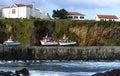 Boats on the shore at santa cruz azores archipelago portugal in harbor of flores island Stock Photos