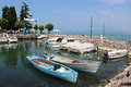 Boats in a small harbor at peschiera lake garda moored the southern end of italy Stock Images