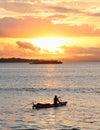 Boats on sunset sea