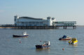 Boats in weston super mare bay and the pier in this popular west country tourist destination in somerset england Royalty Free Stock Photography