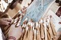 Bobbin lace detail of hands making Royalty Free Stock Photos