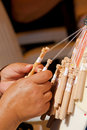 Bobbin lace making Stock Photo