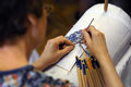 Bobbin lace making the woman maker at work traditional crafts folk art selective focus Royalty Free Stock Photography