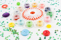 Bobbins, buttons on white Stock Photography