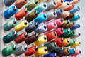 Bobbins with colored thread for industrial textile Royalty Free Stock Photo